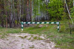 Entry is prohibited, the barrier is closed and stay in the forest and hunting is prohibited royalty free stock image