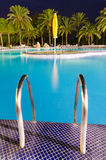 Entry rails to the evening tropical pool Royalty Free Stock Photography