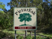 The entry sign board into Esk using a play on words to call it PicturEsk. Esk, Queensland, Australia: February 9, 2018: The entry sign board into Esk using a Royalty Free Stock Images
