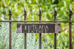Entry Signboard Background. French and spanish entry signboard on a fence Royalty Free Stock Image