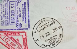 Entry stamps and visas on Passport royalty free stock images
