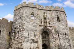 Entry to Caernarfon castle, Wales, UK. Entry to Caernarfon castle. Wall of Caernarfon castle, Wales, UK. Sunny day Stock Image