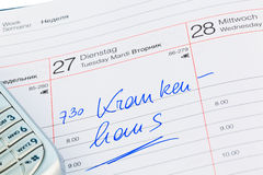 Entry to the calendar: hospital. A date is entered on a calendar: hospital Stock Image