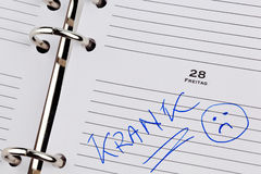 Entry to the calendar: sick. A date is entered on a calendar: sick Royalty Free Stock Photography