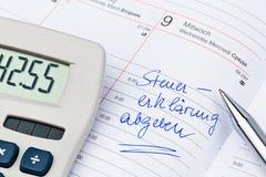 Entry to the calendar: tax return Stock Photo