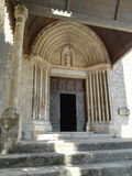 Entry to church. Big door to church with columns and many embellishments Stock Photos