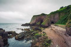 Entry to the Cushendun Cave in Northern Ireland royalty free stock photography