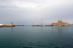 Entry to Mandraki Harbour in Rhodos stock photography