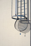 An entry to the roof access ladder with shade  on a building wal Royalty Free Stock Photography