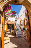 Entry to Tefany's coffee bar in Lindos Royalty Free Stock Images