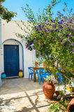 Entry to typical Greek house. With blue dores and green trees in garden, Greece Royalty Free Stock Photos