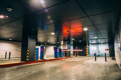 Underground garage or modern car parking. Entry into Underground garage or modern car parking, barrier and the control system for driving in cars Stock Images