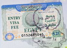 Entry Visa Fee Egypt in Passport. Stamp of Entry Visa Fee in Passport to Egypt. Hurghada International Airport. Cost $25. Arabic lettering stock photo