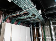 Entry of wiring to electrical panel stock image
