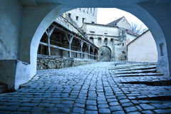 Entryway into old fortress, Sighisoara, Romania. Arched entryway into old fortress, Sighisoara, Romania Stock Photos