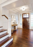 Entryway and Stairs in New Home. Entryway with furnishings and elegant craftsmanship stock photos
