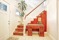 Entryway with tile floor, staircase and vintage console table Stock Images