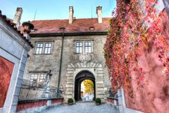 Entryway to the castle during fall in Cesky Krumlov royalty free stock images