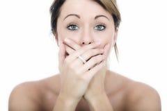 Entsetzte verlegene junge Frau Stockfoto