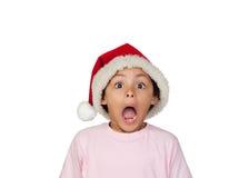 Entsetztes Mädchen, das Santa Hat trägt Lizenzfreie Stockfotos