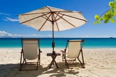 Entspannen Sie sich auf dem Strand Stockbild