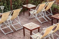 Entspannen Sie sich Punkt mit Strand-Stuhl Stockbilder