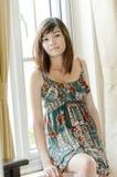 Entspannende Attrative asiatische Frau Stockfoto