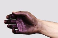 Entspannte Hand in der purpurroten Farbe Stockfoto