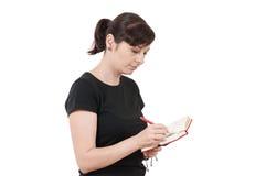 Entspannte Schreibensanmerkungen der jungen Frau Stockbild