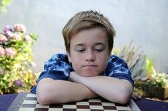 Enttäuschter Schachspieler Stockfoto