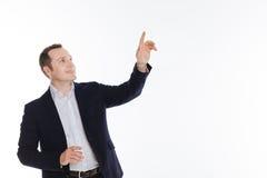 Entusiastisk flott gentleman som pekar på något royaltyfria foton