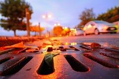 Entwässerungsabwasserkanal bei Sonnenuntergang Lizenzfreies Stockfoto