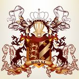 Entwerfen Sie mit königlichem heraldischem Element von den Bändern, von der Krone und vom shiel Stockfoto