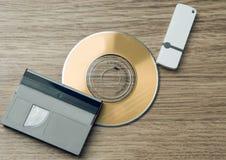 Entwicklungsmedien Kassette, CD, greller Antrieb Stockbild