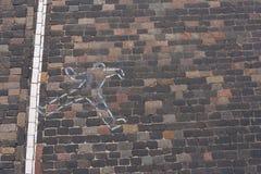 Entwurf einer Person, die absolut auf der Straße gelegen ist Lizenzfreie Stockbilder