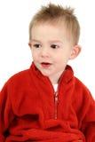 Entzückender Einjahresjunge in der roten Strickjacke Stockfotos