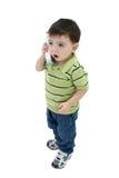 Entzückender Junge, der am Haus-Telefon über Weiß spricht Lizenzfreie Stockfotografie