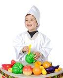 Entzückender zukünftiger Koch Lizenzfreie Stockfotos