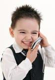 Entzückendes Baby in der Klage auf Mobiltelefon lizenzfreies stockbild