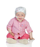 Entzückendes Baby mit einem Kopftuch, welches die Krankheit schlägt Stockbilder