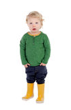 Entzückendes blondes Baby mit gelben gumboots Stockfotos
