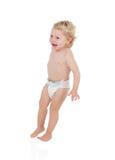 Entzückendes blondes Baby mit zwei Jahren in der Windel Stockbilder