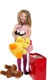 Entzückendes blondes kleines Mädchen mit dem rosa Kleid, das ihren Favoriten hält Stockbilder