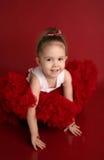 Entzückendes kleines Mädchen im roten pettiskirt Ballettröckchen Lizenzfreies Stockbild