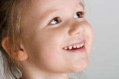 Entzückendes lächelndes Mädchen Lizenzfreie Stockfotos