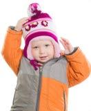 Entzückendes Mädchen, das oben Winterjacke und -hut kleidet Stockbilder