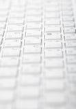 Entziehen Sie grauen Hintergrund - Computertastatur Stockbilder