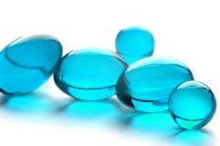 Entziehen Sie Pillen in der cyan-blauen Farbe Stockfotos