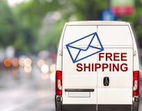 Envío gratis blanco Van que conduce rápidamente en la calle del bokeh del blurr de la ciudad Imagen de archivo libre de regalías