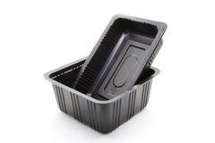 Envase de comida plástico negro Imagenes de archivo